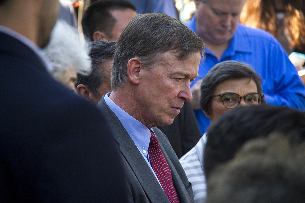 Colorado Governor John Hickenlooper listens to a speaker during a press conference on the state capitol steps, calling out Donald Trump as a racist candidate. June 8, 2016. (Kevin J. Beaty/Denverite)  denver; denverite; governor john hickenlooper; capitol; capitol hill; speech; kevinjbeaty; colorado