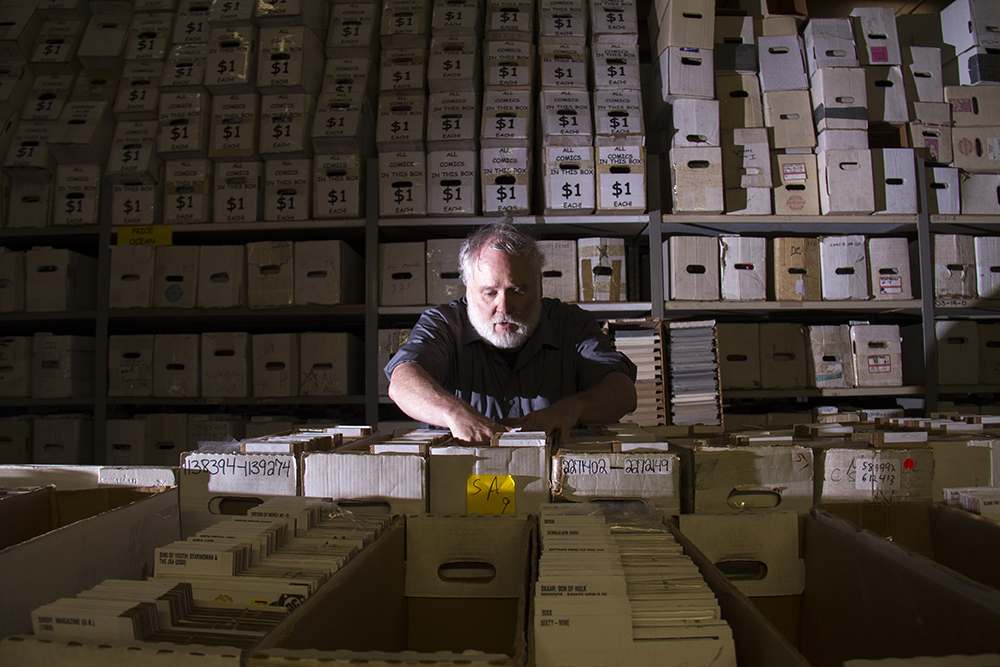 Jake Johns, a comic book collector for 40 years, lives his dream job organizing Mile High Comics' collection that holds an estimated 1,373,400 issues. The company is America's largest comics dealer. (Kevin J. Beaty/Denverite)  mile high comics; retail; denver; colorado; denverite; kevinjbeaty;