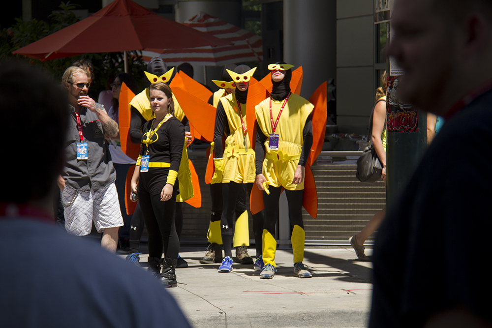 Evil Henchmen from the cartoon, The Venture Brothers, casually wait to cross 14th Street. Denver Comic Con on June 19, 2016. (Kevin J. Beaty/Denverite)  denver comic con; convention center; denver; colorado; denverite; kevinjbeaty
