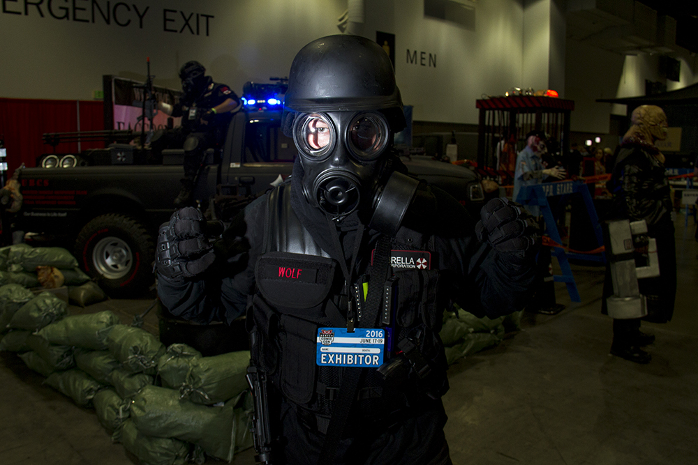 A paramilitary fellow from the Umbrella Corporation stakes out in front of an exhibitor booth for the Resident Evil game series. (Kevin J. Beaty/Denverite)  denver comic con; convention center; denver; colorado; denverite; kevinjbeaty