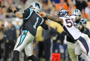 Denver Broncos linebacker Von Miller (58) strip sacks Carolina Panthers quarterback Cam Newton (1) during fourth quarter action in Super Bowl 50 at Levi's Stadium in Santa Clara, CA, February 7, 2016. Photo by Ben Hays.
