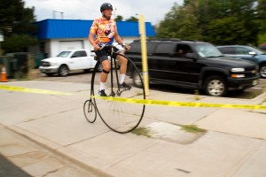 Paul Brekus and his penny-farthing bicycle and vintage moustache. The Bannock Street Criterium. July 31, 2016. (Kevin J. Beaty)  biking; bike; cycling; golden triangle; bannock street criterium; denver; colorado; sports; kevinjbeaty; denverite;