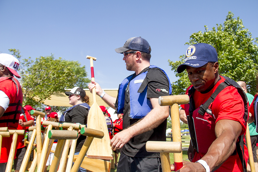 US Senate candidate Darryl Glenn picks an oar before a race at the Colorado Dragon Boat Festival. July 31, 2016. (Kevin J. Beaty/Denverite)  denver; colorado dragon boat festival; race; election; politics; darryl glenn; kevinjbeaty; denverite; colorado; sloan lake;