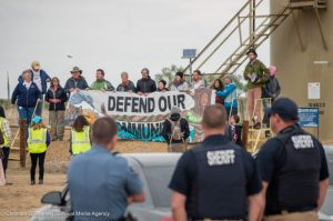 Lakewood police officers went undercover to keep tabs on a land auction protest. (Christian O'Rourke/Survival Media Agency)