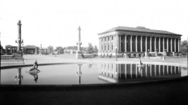 Civic Center, Denver, Colorado; view southwest across Sea Lion Fountain, Main Library, the Greek Theater and Colonnade of Benefactors; scene includes dirt walkways, lampposts, sea lion and baby bronzes in pool, Bucking Bronco and Indian Scout monuments. (Louis Charles McClure/Denver Public Library/Western History Collection/MCC-2840)  capitol hill; civic center; historic; denver public library; dpl; archive; archival; denverite