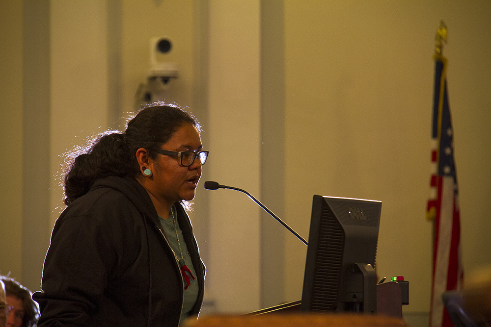 "Miriam ""Mimi"" Mardrid Puga speaks during a Denver City Council public hearing on the status of the Office of the Independent Monitor. Aug. 15, 2016. (Kevin J. Beaty/Denverite)  protest; denver city council; government; city and county building; denver justice project; kevinjbeaty; denver; denverite; colorado;"