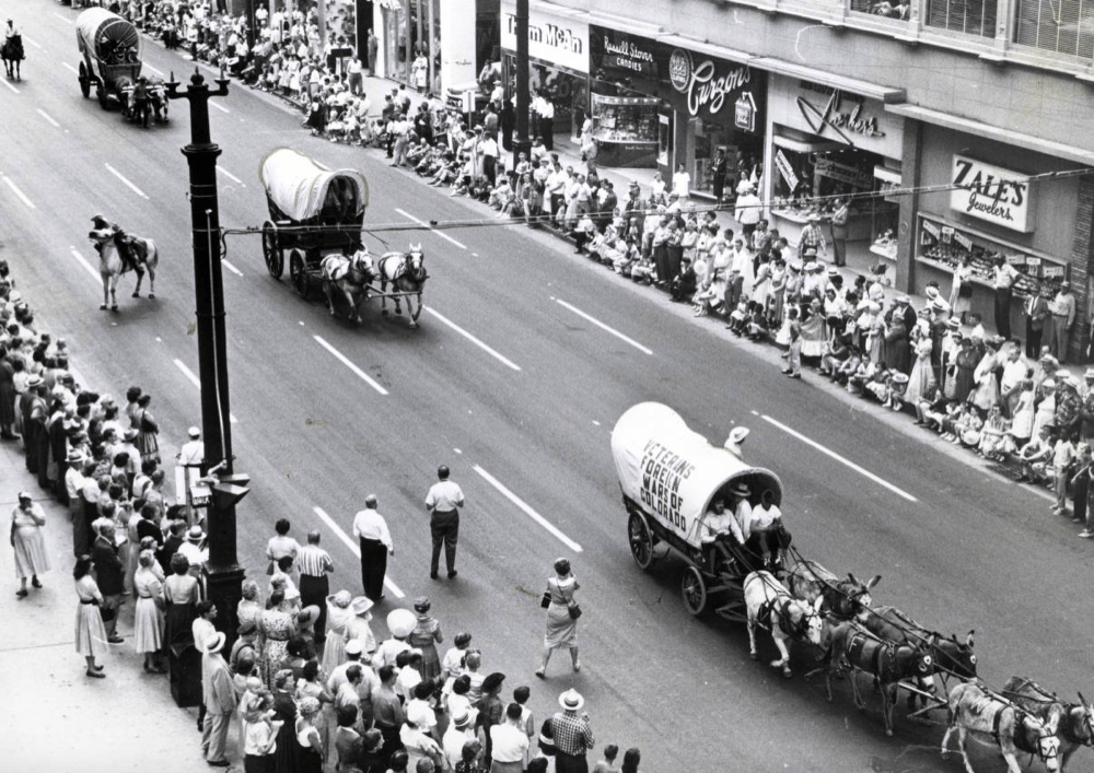 Covered wagons on 16th Street during the Centennial Fiesta to celebrate Colorado's 83rd birthday as a state on August 12, 1958. (Dick Davis/Denver Public Library/Rocky Mountain News Photograph Collection/RMN-055-6822)