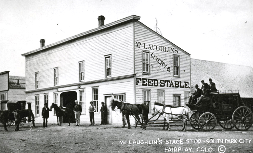 "A stagecoach is parked outside McLaughlin's livery stable in South Park City (now Fairplay) in Park County, Colorado. Shows a two story wooden building with a shed roof, cornices, brick chimneys and a flat arched entrance. Men stand near horses and a carriage. A sign painted on the side of the building reads: ""McLaughlin's Livery & Feed Stable."" 1870-1880. (Denver Public Library/Western History Collection/Z-15636)  south park; fairplay; history; historic; denver public library; dpl; archive; archival; denverite;"