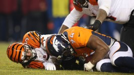 Denver Broncos defensive end DeMarcus Ware (94) recovers a fumble by Cincinnati Bengals quarterback AJ McCarron (5) to end the game during overtime quarter action against the Cincinatti Bengals during the game at Sports Authority Field at Mile High in Denver, CO, December 28, 2015. Photo by Gabriel Christus