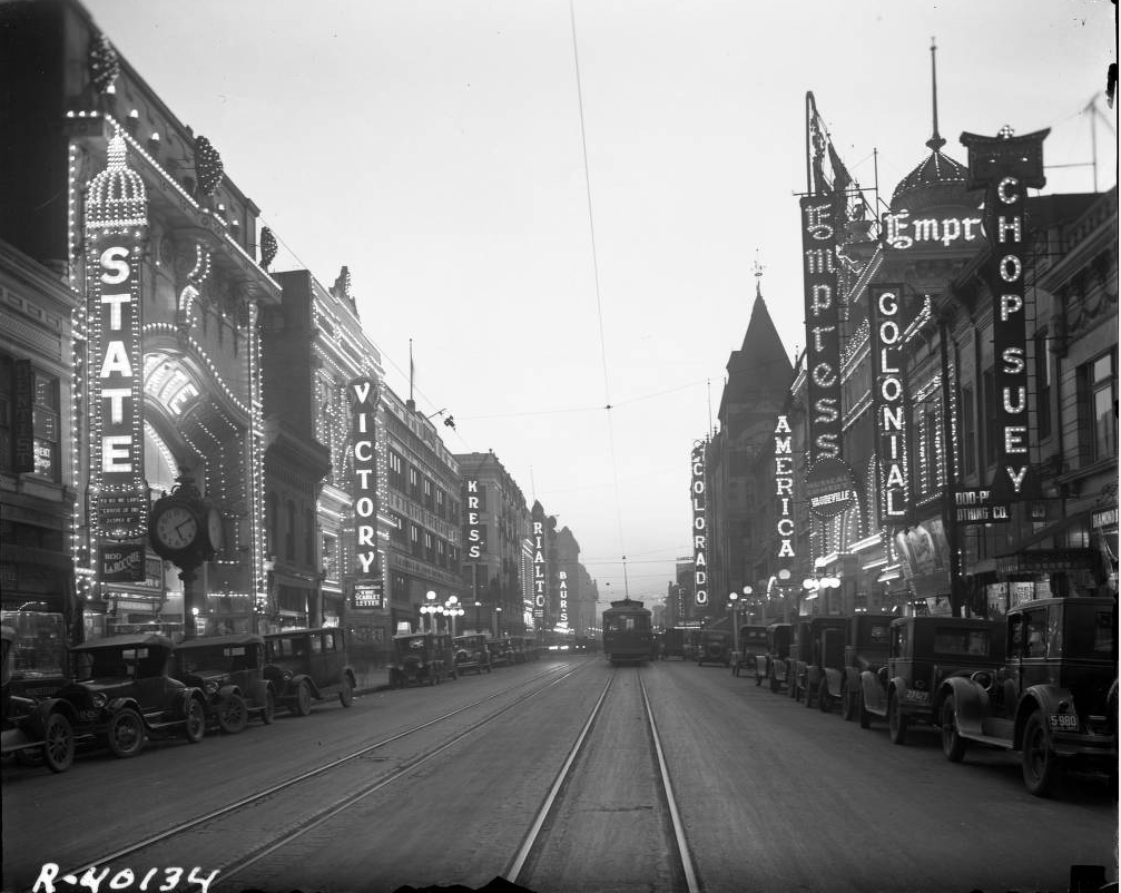 """A view down Curtis Street, referred to as """"Theater Row"""" sometime between 1927 and 1930. (Denver Public Library/Western History Collection/Rh-77)"""