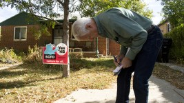 Denver Republican Party volunteer Frank Wiederman inspects a canvassing map as he knocks on doors to whip votes. Oct. 15, 2016. (Kevin J. Beaty/Denverite)  politics; copolitics; canvas; election; republican; denver; denverite; colorado; kevinjbeaty;