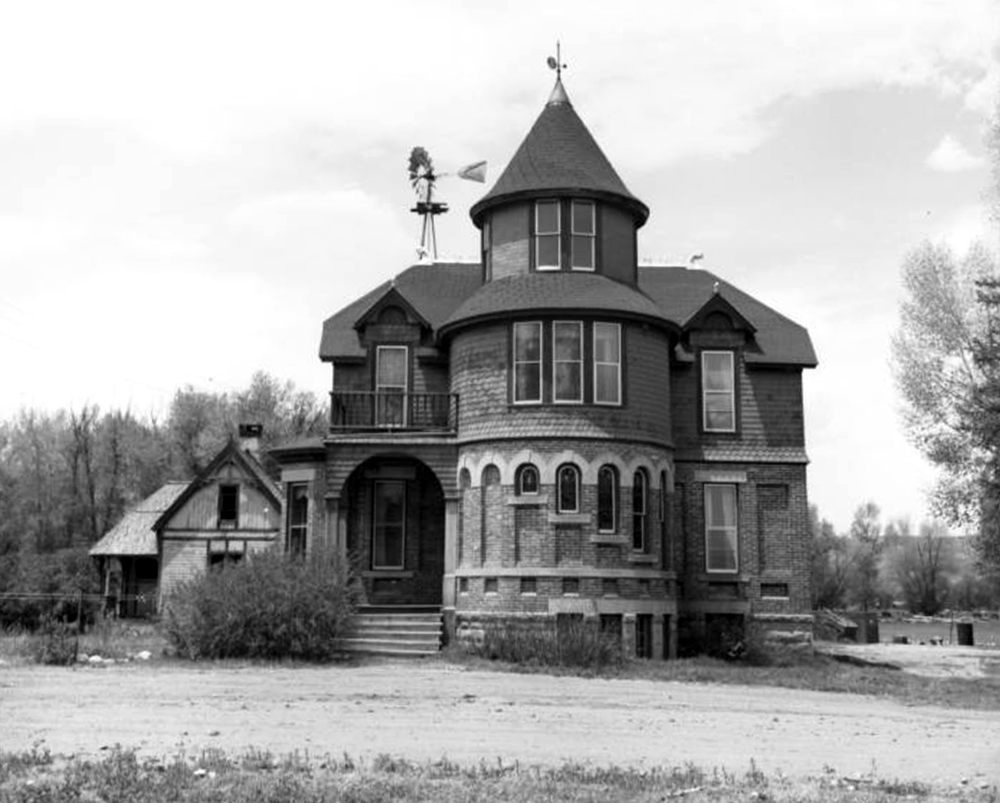 Exterior of the Dos Rios Ranch Mansion built by Alonzo and Annie Hartman in 1892, west of Gunnison, Colorado. Between 1960 and 1965. (Sandra Dallas/Denver Public Library/Western History Collection/X-9373)  history colorado; historic; denver public library; dpl; archive; archival; denverite