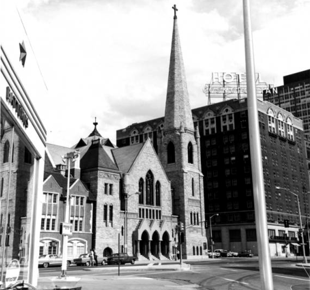 A black and white photograph of Trinity United Methodist Church. The Hotel Cosmopolitan can been seen across the street from the church. Circa 1965. (Sandra Dallas/Denver Public Library/Western History Collection)  history colorado; historic; denver public library; dpl; archive; archival; denverite