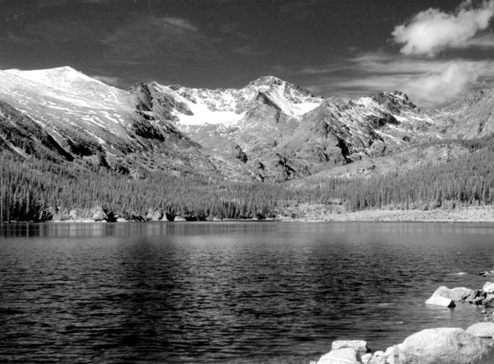 Silver Lake stands in the foreground in Boulder County, Colorado, with a ridge of mountains in the distance. Between 1935 and 1950. (Donald Kemp/Denver Public Library/Western History Collection/K-97)  five points; historic; denver public library; dpl; archive; archival; denverite