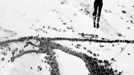A large crowd watches a ski jumper at a ski resort in Colorado, possibly Steamboat Springs. Between 1930 and 1939. (Harry Mellon Rhoads/Denver Public Library/Western History Collection/Rh-1249)  historic; denver public library; dpl; archive; archival; denverite