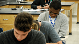 Students at Aurora Central High School work on an assignment during class during the spring of 2015. (Nicholas Garcia/Chalkbeat)