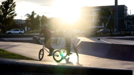 BMX riders take in the sunset at the Denver Skate Park. (Andrew Kenney/Denverite)