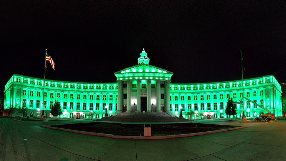 The City and County Building lit up green for Veteran's Day. (Kevin J. Beaty/Denverite)