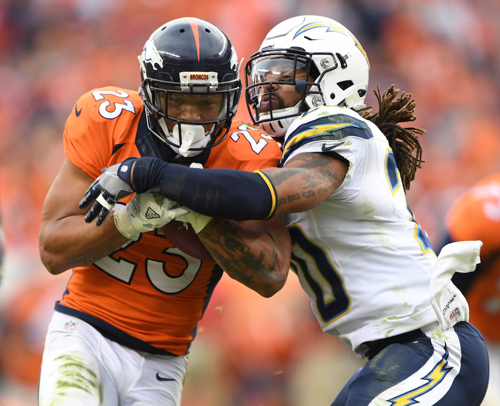 Denver Broncos Devontae Booker (23) fights for extra yardage on a third quarter reception  against the San Diego Chargers in the NFL game at  Sports Authority Field in Denver, Colo. October 30, 2016.Photo: © Eric Lars Bakke/ Denver Broncos)