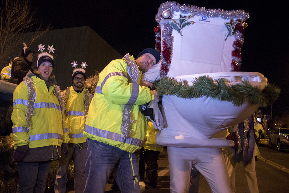 Steve Snyder and the Denver Water Running Toilet at the parade of lights. Dec. 2, 2016. (Kevin J. Beaty/Denverite)