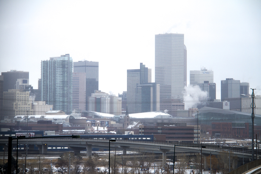 A snowy Denver skyline; (Kevin J. Beaty/Denverite)  skyline; cityscape; cowx; weather; cold; snow; winter; kevinjbeaty; denver; colorado; denverite;