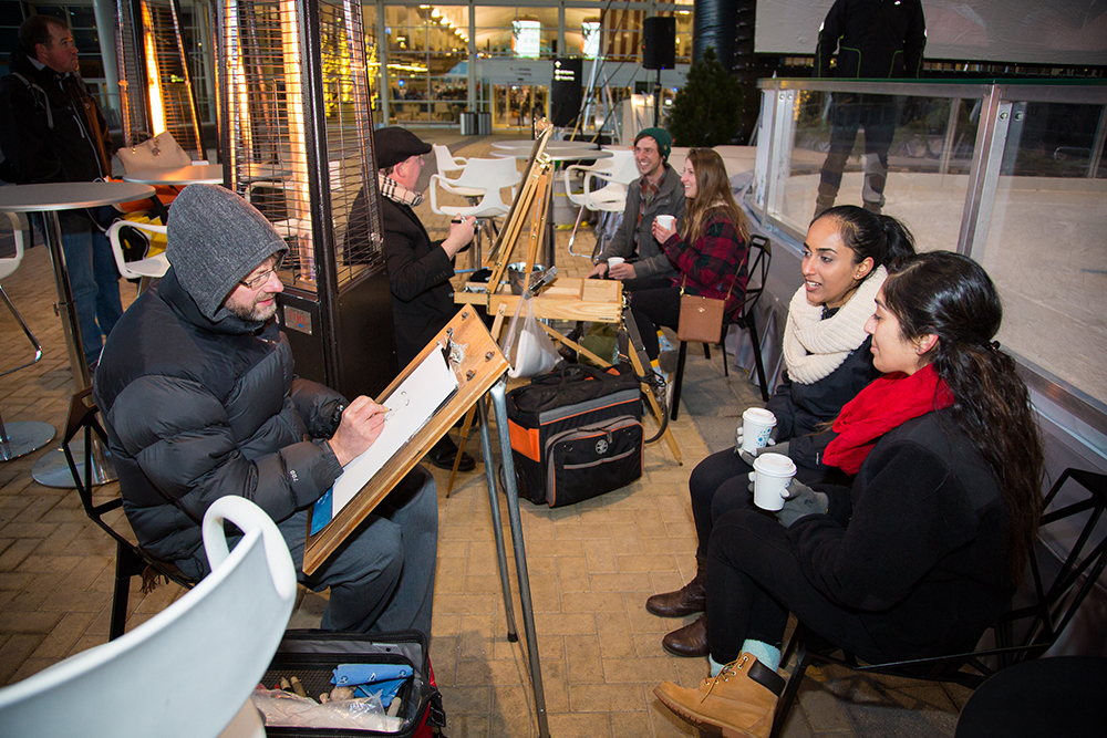 Shubha Swamy and Siya Kasawala are sketched at Film on the Fly, Dec. 16, 2016. (Photograph provided courtesy of Denver International Airport)  2016; christmas vacation; event; film on the fly; plaza; dia; denver international airport