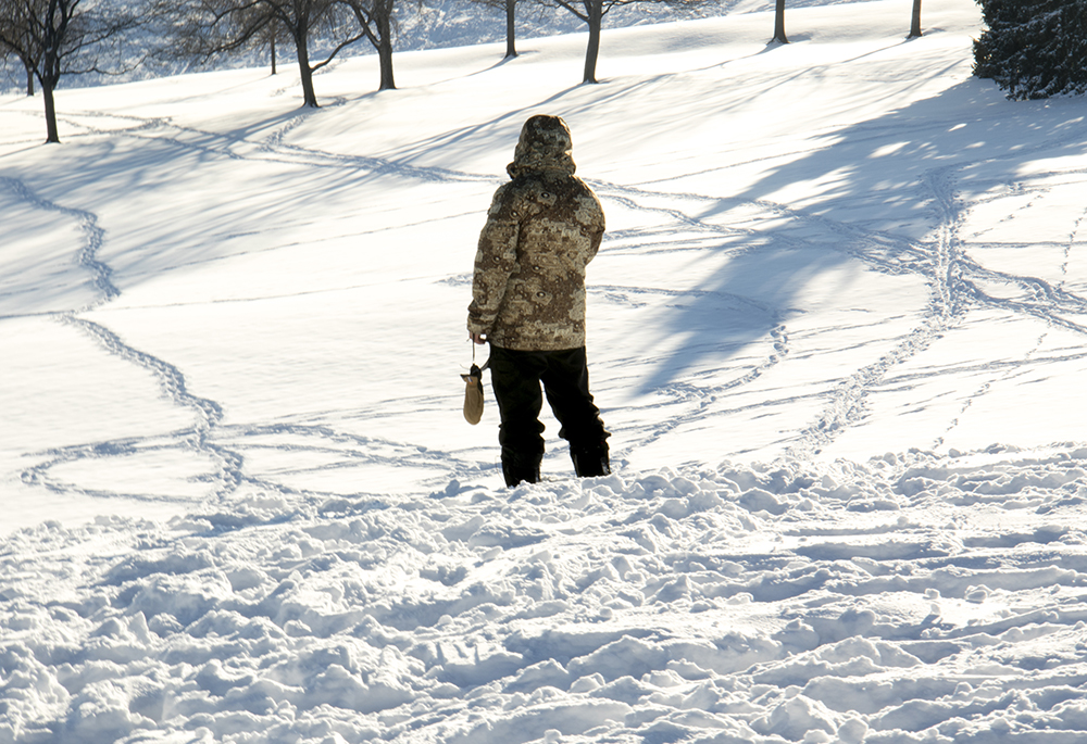 Matthew Perez overlooks Ruby Hill park which is crisscrossed with trails in the snow. Dec. 17, 2016. (Kevin J. Beaty/Denverite)  snow day; winter; sledding; denver; denverite; colorado; kevinjbeaty;