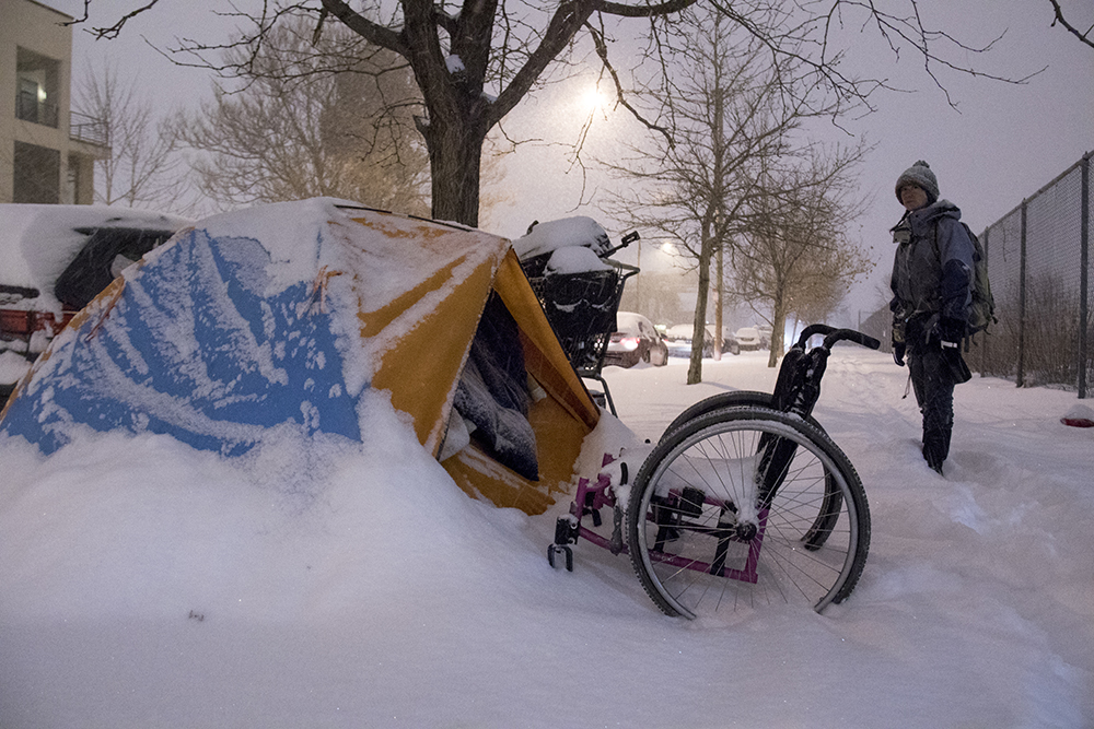 Terese Howard walks Denver on a freezing night to check in on people camping in the blizzard. Dec. 17, 2016. (Kevin J. Beaty/Denverite)  homeless; right to rest; camping ban; blizzard; snow; denver; denverite; kevinjbeaty; colorado; five points;