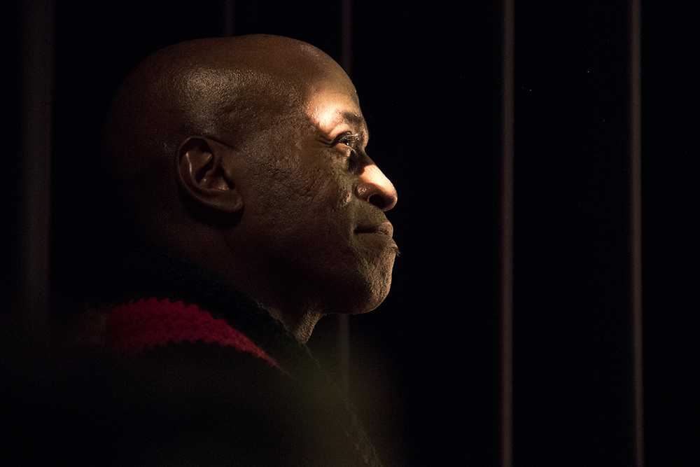 Chet Sisk watches from stage right. The first night of Kwanzaa at the Cleo Parker Robinson Dance Theatre, Dec. 26, 2016. (Kevin J. Beaty/Denverite)  kwanzaa; Cleo Parker Robinson Dance Theatre; holidays; denver; denverite; kevinjbeaty; colorado; five points;