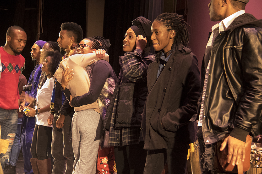 All of the college students in the audience are called down to the stage. The first night of Kwanzaa at the Cleo Parker Robinson Dance Theatre, Dec. 26, 2016. (Kevin J. Beaty/Denverite)kwanzaa; Cleo Parker Robinson Dance Theatre; holidays; denver; denverite; kevinjbeaty; colorado; five points;