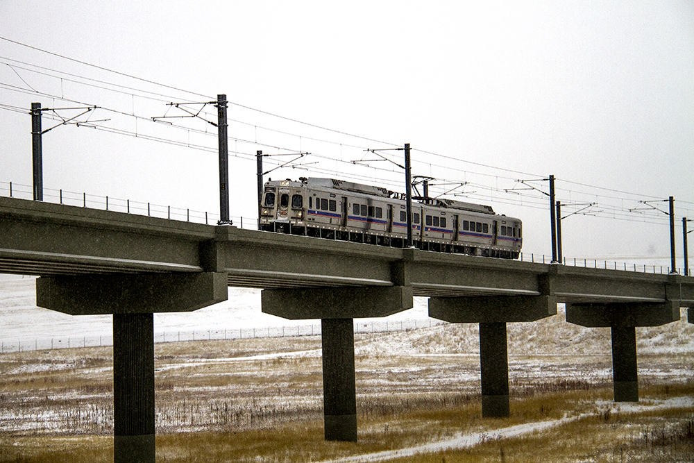 The University of Colorado A Line. Jan. 5, 2016. (Kevin J. Beaty/Denverite)  a line; train; rtd; snow; weather; cowx; denverite; denver; colorado; kevinjbeaty;