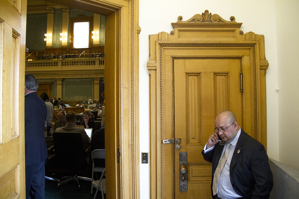 House District 31 Representative Joe Salazar speaks outside the House chambers before Governeor John Hickenlooper's annual State of the State Address. Jan. 12, 2017. (Kevin J. Beaty/Denverite)  state of the state; copolitics; politics; governor john hickenlooper; capitol; kevinjbeaty; colorado; denver; denverite;