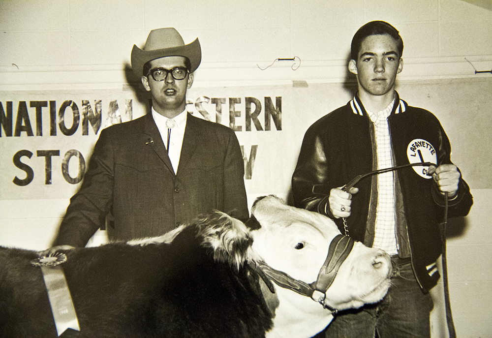 """Charles Waneka wins a ribbon in the """"catch-it-calf"""" competition at the 1967 National Western Stock Show. (Denver Public Library/Western History Collection/Denver Metro Chamber of Commerce Records)  denver; denverite; denver public library; western history collection; archive; archival; National Western Stock Show; nwss;"""