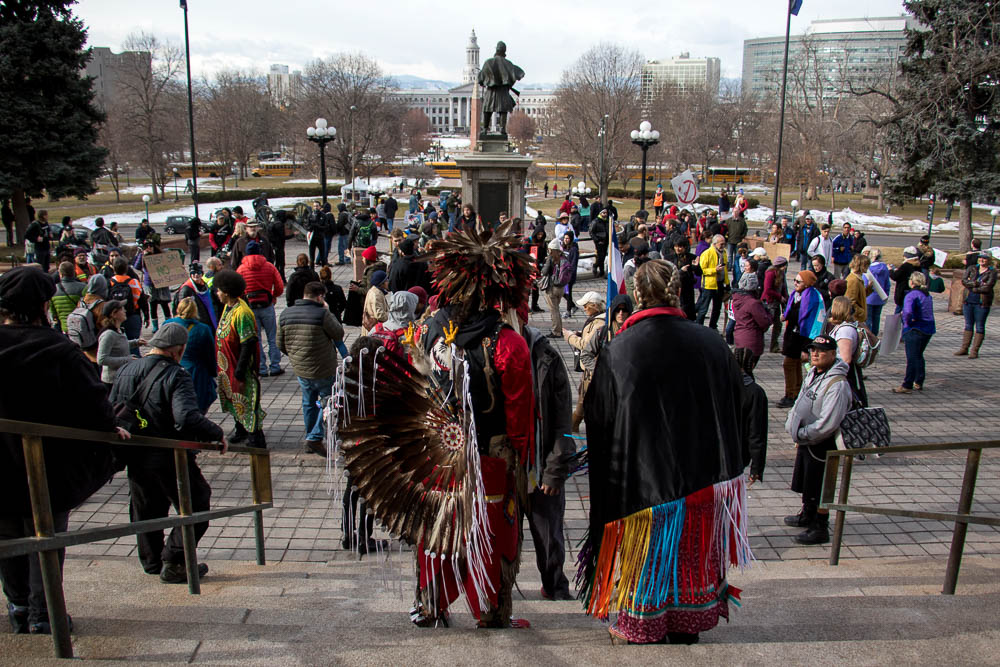 Protesters gather on the Capitol steps on Trump's inauguration day. (Chloe Aiello/Denverite)