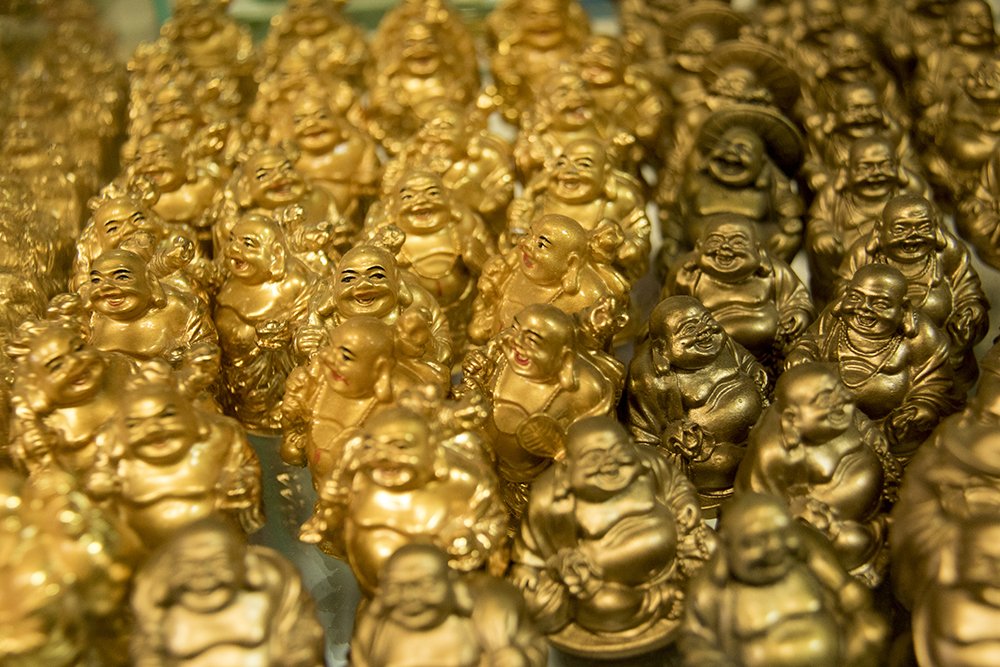 A gaggle of Buddha. Chinese New Year, Jan. 29. 2017. (Kevin J. Beaty/Denverite)chinese new year; federal boulevard; westwood; denver; kevinjbeaty; denverite; colorado;