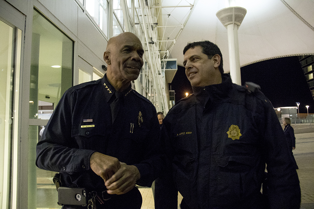 Denver Police Chief White (right) and Commander Lopez at protests at DIA, Jan. 28, 2017. (Kevin J. Beaty/Denverite)  amal kassir; immigration; refugees; politics; protest; copolitics; rally; dia; denver; colorado; kevinjbeaty;