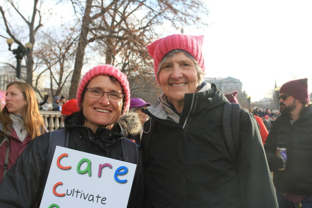 Julie Haverluk (left) and Mary Bruning, of Colorado Springs, participate in the Women's March on Denver on Saturday, Jan. 21, 2017.