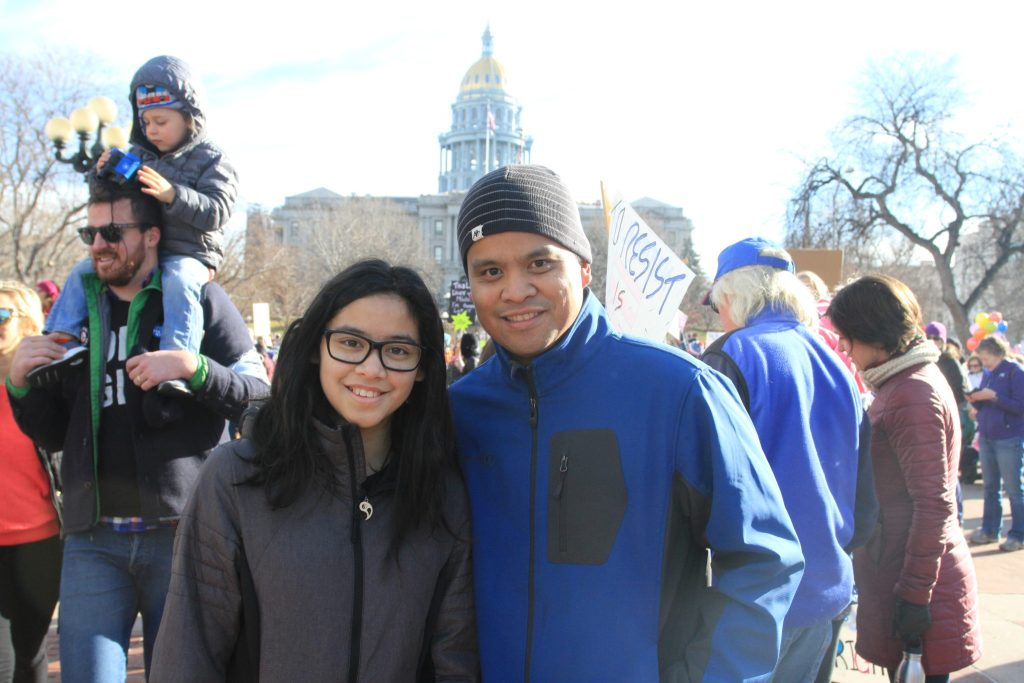 Emerson Plantilla, 13, and her father, Socrates Plantilla, 39, attend the Women's March on Denver on Saturday, Jan. 21, 2017.