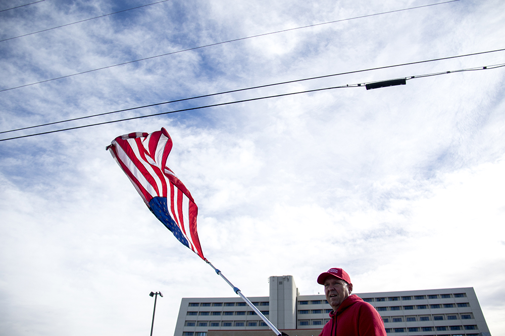 """Jeff McNamara, the """"flag guy,"""" does his thing. A """"Defund Planned Parenthood"""" Rally outside Planned Parenthood of the Rockies, Feb. 11, 2017. (Kevin J. Beaty/Denverite)  abortion; pro life; planned parenthood; denver; colorado; kevinjbeaty; denverite; copolitics; politics;"""
