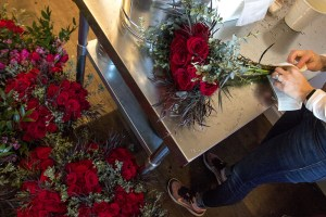 Prepping bouquets on Valentine's Day at Flower Bombers flower delivery, Feb. 14, 2017. (Kevin J. Beaty/Denverite)  valentine's day; flowers; love; retail; kevinjbeaty; denver; denverite; colorado;