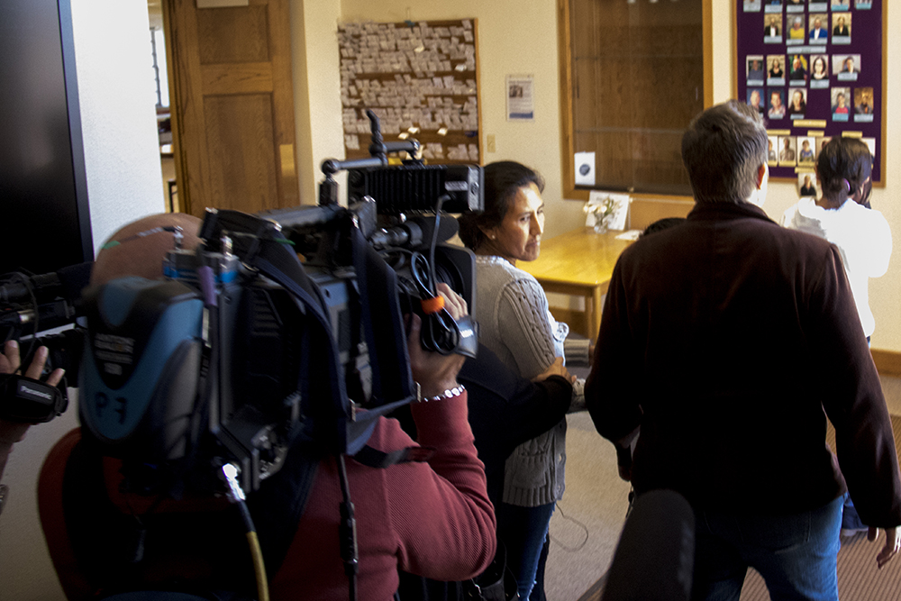 Jeanette Vizguerra heads to her room in the First Unitarian Society of Denver, surrounded by press, Feb. 15, 2017. (Kevin J. Beaty/Denverite)  jeanette vizguerra; immigration; undocumented; deportation; sanctuary; denver; colorado; kevinjbeaty; denverite;