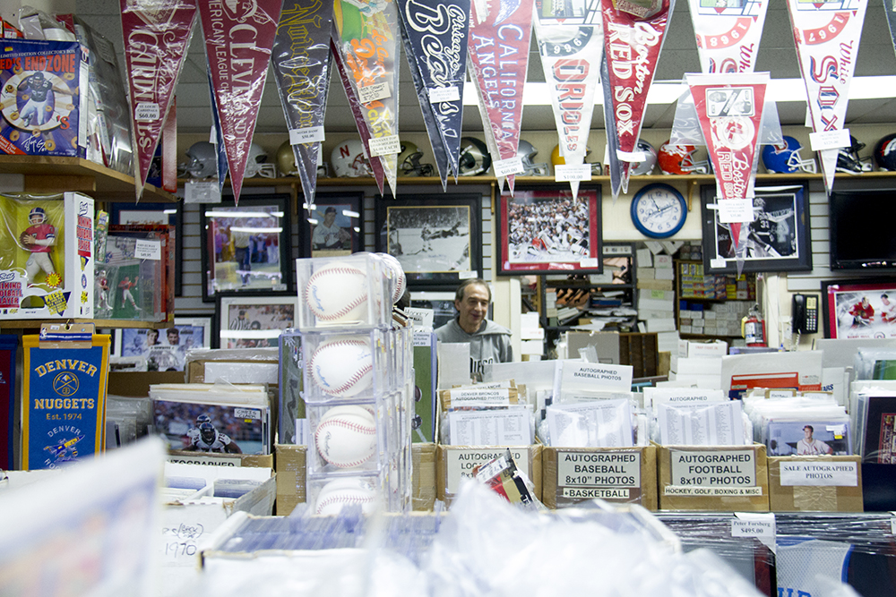 Bill Vizas in his Overland store, Bill's Sports Collectibles, Feb. 20, 2017. (Kevin J. Beaty/Denverite)  sports; bill's sports collectibles; retail; kevinjbeaty; denver; denverite; colorado; south broadway; overland;