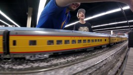 Ricky McDonald howls as a trian goes by. The Rocky Mountain Toy Train Show, Mar. 4, 2017. (Kevin J. Beaty/Denverite)  hobby; toy train; model train; toys; kevinjbeaty; denver mart; rocky mountain toy train show; colorado; denver; denverite;