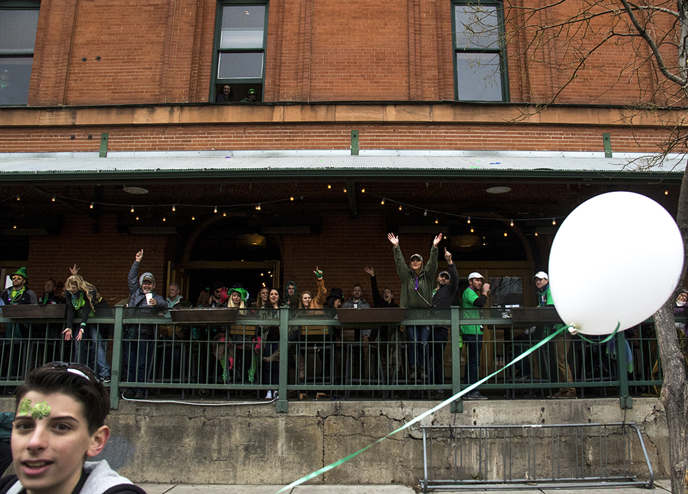 Patrons at the Wynkoop Brewery clamour for green beads. St. Patrick's Day celebration, March 11, 2017. (Kevin J. Beaty/Denverite)st. patricks day; union station; kevinjbeaty; denver; colorado; denverite;