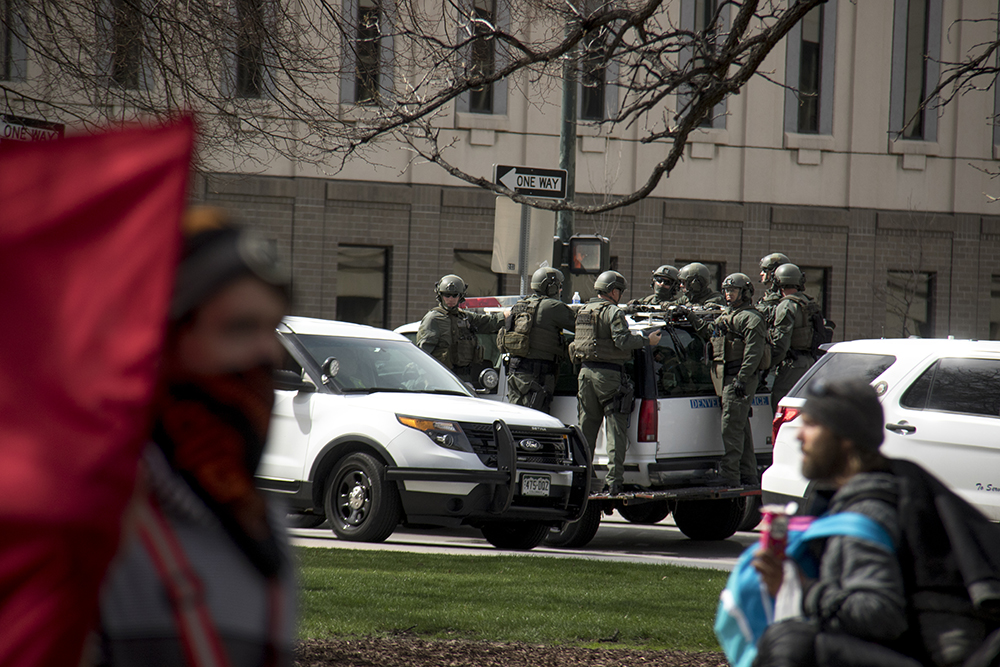 "Riot police stand by, ready for action. A ""Make America Great Again"" rally at Civic Center Park, March 25, 2017. (Kevin J. Beaty/Denverite)  protest; rally; kevinjbeaty; denverite; denver; colorado; civic center park; copolitics;"