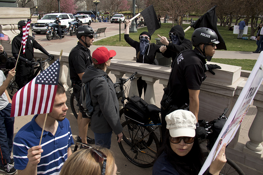 "Anarchist activists yell obsenities at marching Trump supporters. A ""Make America Great Again"" rally at Civic Center Park, March 25, 2017. (Kevin J. Beaty/Denverite)  protest; rally; kevinjbeaty; denverite; denver; colorado; civic center park; copolitics;"