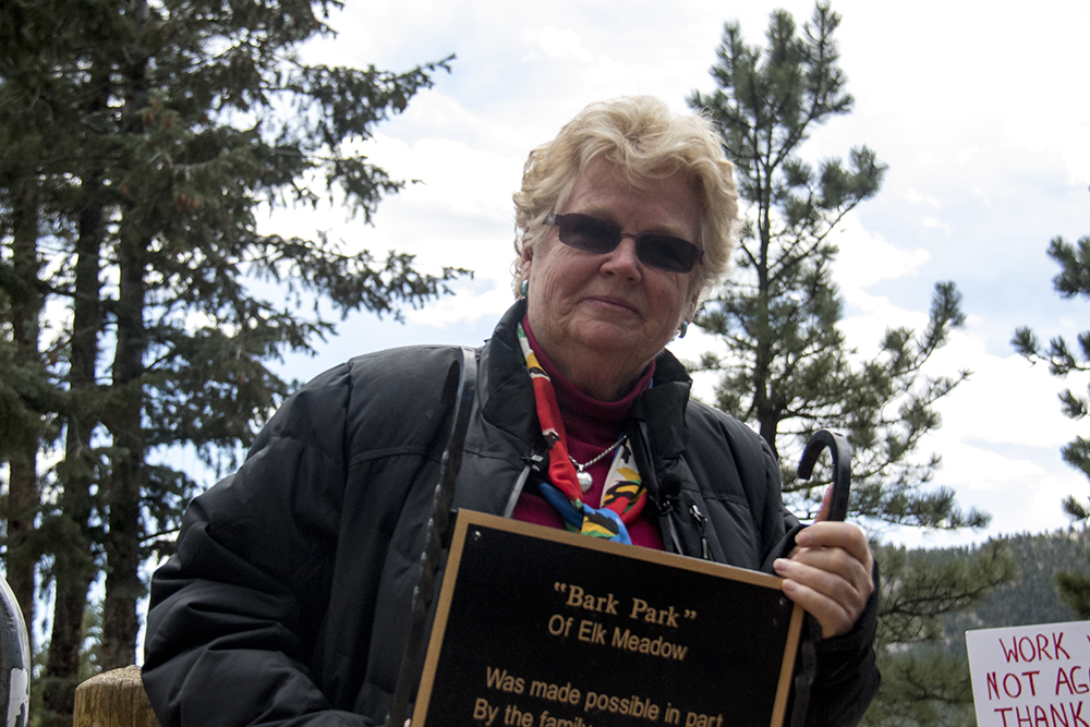 Elk Meadow Dog Park founder Judi Quackenboss holds a memorial plaque for her son that she's removed from the space before it closes. March 30, 2017. (Kevin J. Beaty/Denverite)