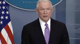 Jeff Sessions threatens sanctuary cities with loss of funding at a press conference March 27, 2017. (Screen shot from Washington Post video.)