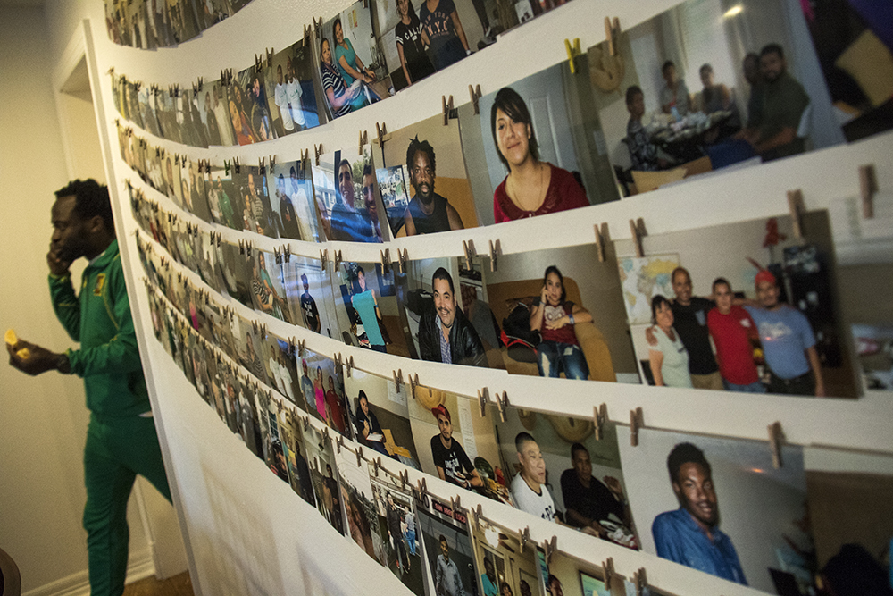 A wall of portraits of people that Casa De Paz has hosted over the years. They've since moved to a new location. March 27, 2017. (Kevin J. Beaty/Denverite)