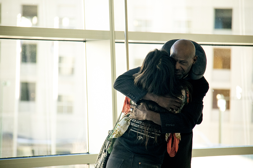 "Jerry Burton hugs Sophia Lawson after all three defendants were found guilty of violating the city's ""urban camping ban."" Lindsey Flanigan Courthouse, April 5, 2017. (Kevin J. Beaty/Denverite)  homeless; urban camping ban; right to rest; lindsey flanigan courthouse; law; kevinjbeaty; denver; colorado; denverite;"